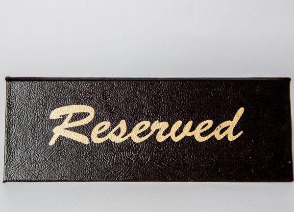Cartel de Reservado